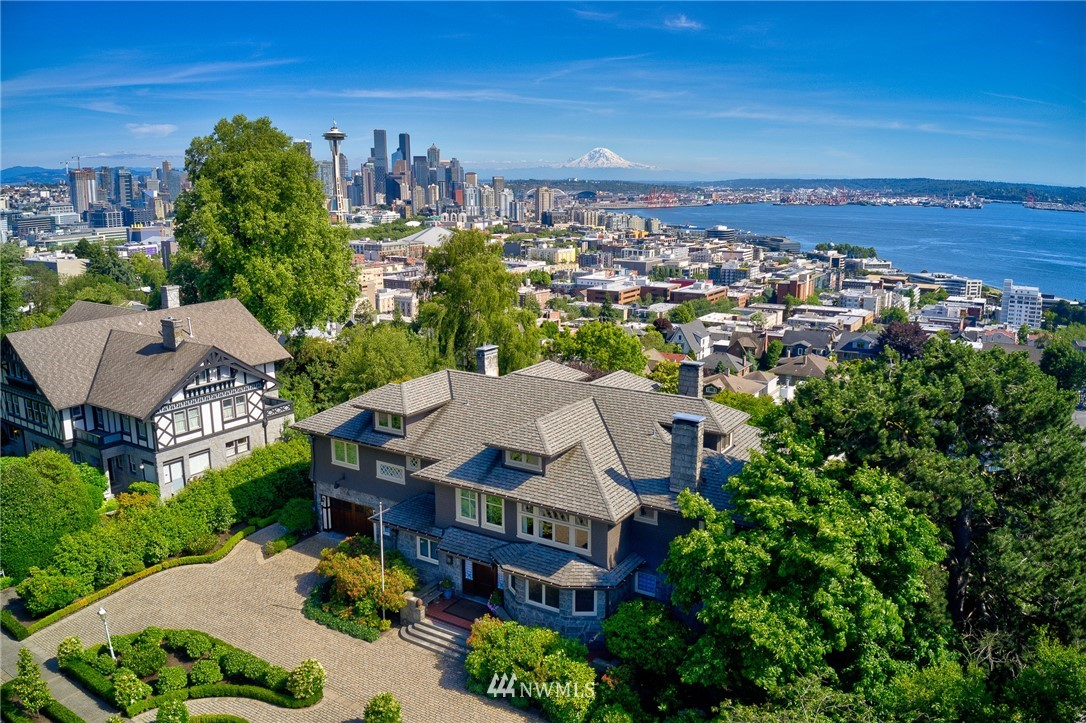 Spectacular West Highland residence thoughtfully restored and set on one of the most coveted lots in Seattle. With a commanding presence, spectacular views and warm interior spaces, this manse will impress even the most discriminating. Enjoy city & water views from the many wonderful indoor and outdoor spaces. Impressive 2 story foyer, top of the line chef's kitchen, luxurious master suite, 5 bed, 7 bath, 7 fireplaces, swimming pool. Relax in the comfort of a fully restored masterpiece.