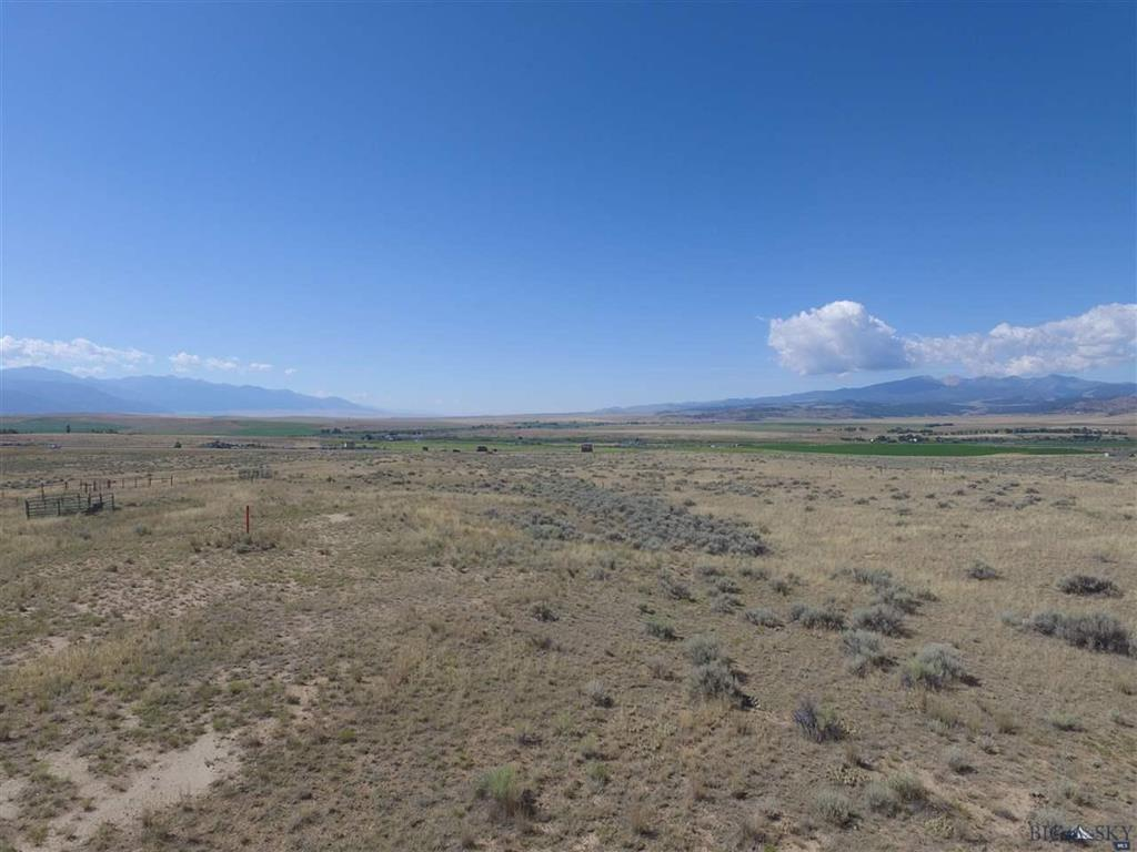 22+ acre with limited covenants.  Allows modulars or a manufactured home if on a permanent foundation.  Natural gas and electricity to the  property.  Sits on high ground at the north end of the Jefferson River Valley overlooking the valley from the Tobacco Root mountains to the Continental Divide.  Fenced and cross fenced with smooth wire for horses and only a short ride to thousand of acres of public land.