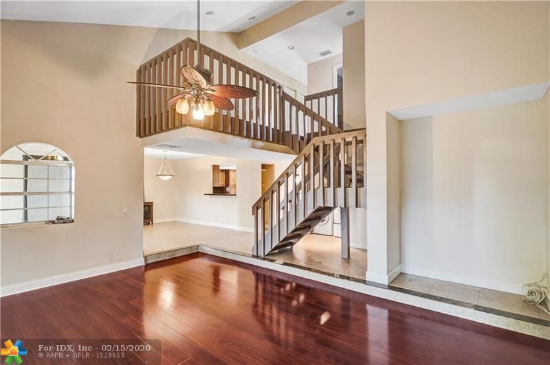This beautiful, spacious 4 bedroom, 2.5 bath townhome is nestled at the end of the cul-de-sac featuring a beautiful golf course view. The home is extremely welcoming with tall ceilings, a large living room, dining area and beautiful kitchen, as well as 1 bedroom and bath downstairs for guests. Upstairs features 3 bedrooms, 2 bath with a large balcony and walk in closet in the master suite. The outside has 3 outdoor spaces; 1 fenced in the front, 2 private screened patios in the back, along with the perfect space in the backyard for a swimming pool. No rental restrictions, pet friendly and low HOA fees. (HOA $140 monthly & Master Assoc Fee $125 once a year). Come see this beautiful property and make your best offer ! Perfect for a family and/or INVESTORS.
