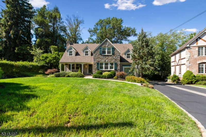 Storybook Colonial w/ beautiful open porch. Gorgeous landscaped yard set on almost 1/4 acre level lot. Located on one of the most picturesque streets in Mountainside on the Westfield side of town. Entranceway foyer opens to living room w/ wood burning fireplace. Formal dining room, updated kitchen with viking stove, sunken family room, laundry room & powder room on first floor. 3 bedrooms and 2 full baths complete the second level. Finished basement with 1/2 bath, rec room & workshop. This home exudes charm with amazing attention to detail throughout including deep moldings, coffered ceilings, bay windows, chair rail, cedar closets & archways. Whole house generator! This is a rare find, will not last!