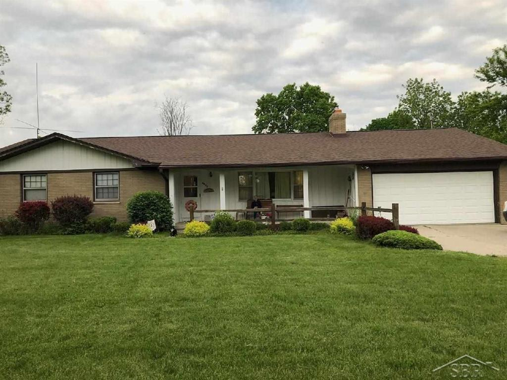 Rare 55.54 acre in Saginaw Twp, spacious four bedroom brick ranch featuring a large living room, two baths, new furnace in 2018, furnace and AC in 2016, WH in 2019, 40X64 pole barn with newer roof, this property is surveyed and ready for development. The crops are subject to the farmers rights and no showings until after the Estate Sale on 7/10/2021.
