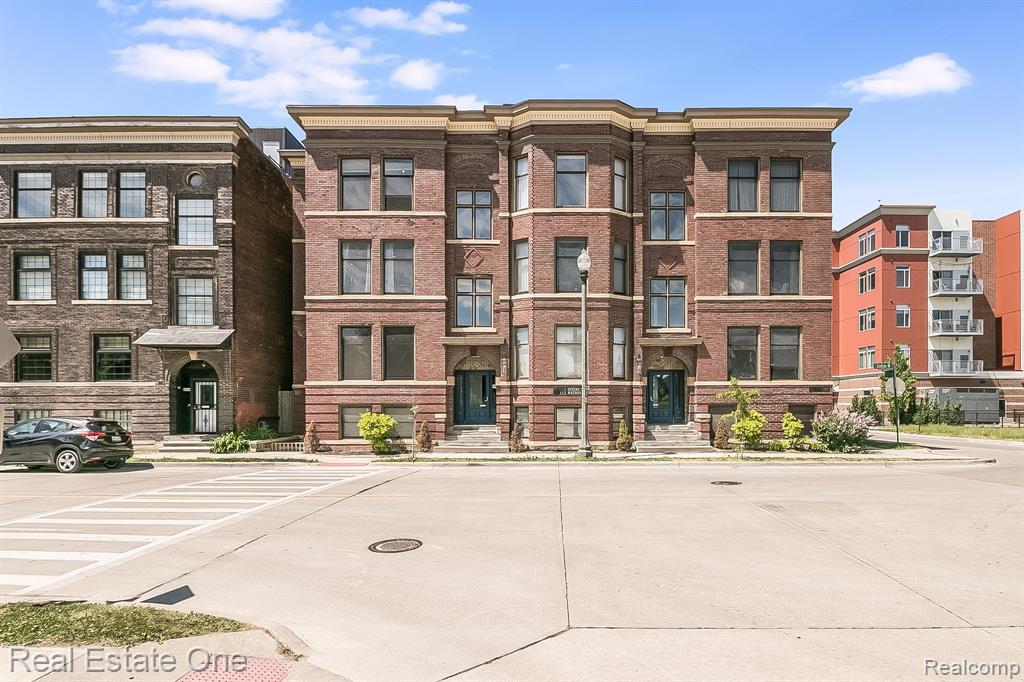 Lamar Loft for sale-- Part of Carola Condo Community-- This Brush Park Loft has great charm and style for those looking for a cool space in the growing community of Brush Park.  Across the street from Grey Ghost or a short stagger down the street to Second Best Bar & 3 blocks from Whole Foods.  From the exposed brick walls to the concrete  floors w/ radiant heat there is efficient means of heating & cooling.  The rear entry area is a perfect space for a wall of built-ins to get you the storage you want or need.  Full size in unit stackable washer/dryer, huge spa shower w/ sitting ledge that can be turned into steam shower.  Large living area proportioned  if you love large cozy couches or minimal furniture.  You have large windows off the west and east. So much to discover, better to see for yourself.  HOA covers: bldg structure insurance, common area maintenance, water, trash sewer, 1 assigned parking space in gated lot, capital reserves, professional property management.