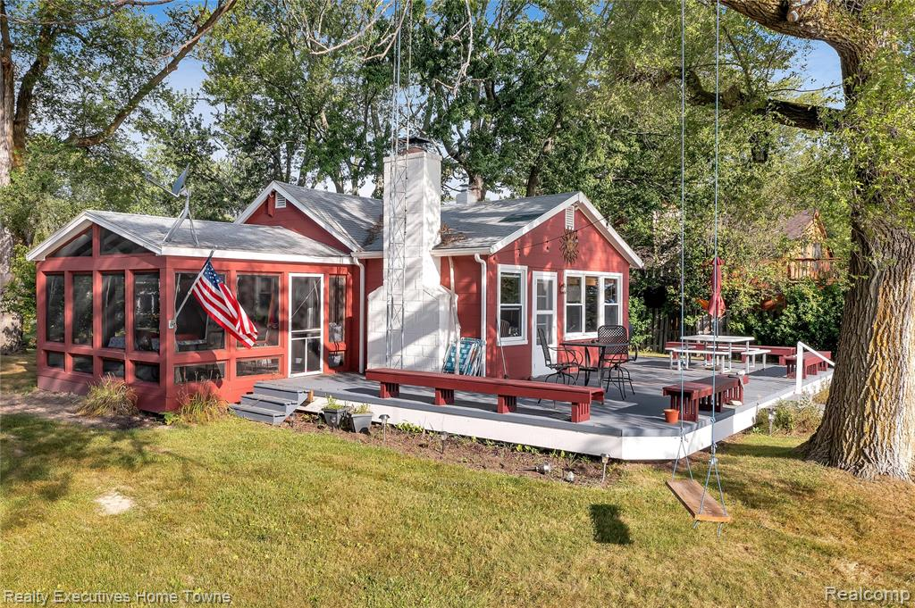 This is a beautiful 4.5 acre parcel, 125 ft frontage with stunning views of gorgeous Lake Huron.  Located on this special site is two cottages, one offers kitchen, bath, great room also sleeping, large screened in porch, big deck across the front with show stopping sunrises.  The newer cottage features kitchen, great room, bath, and bedroom on 2nd floor with open concept and plenty of views too.  The pole barn is 32 x 80 with a double garage door, 2 single garage doors with a large upstairs with plenty of options.  There is also a large paved area for any sport you might enjoy.  The original cottage measures kitchen 10x7, living room 19x18, dining 10x9, bath 8x6, screened in porch is 15x13.  The water connections is paid and sewer assessment is included in the taxes.