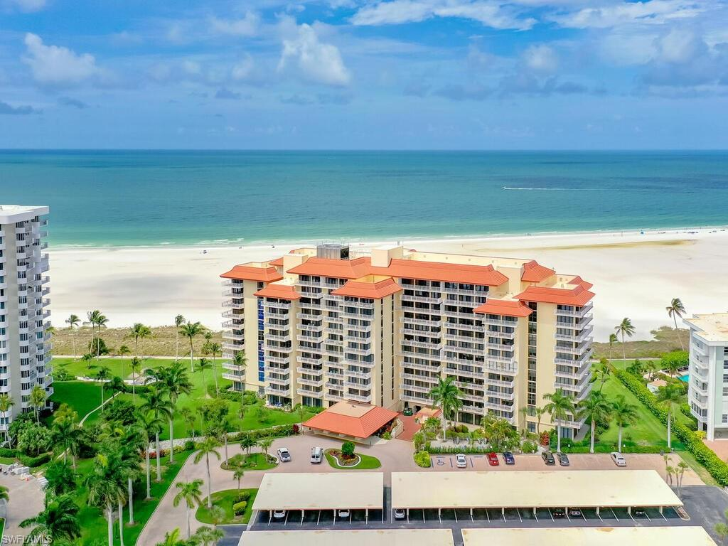 A Jewel of a Condo on Marco Island's Sugar Sand Beach.  Casual Easy Beach Living  in an Historic Marco Building  Built by the Mackle Brothers. Enjoy Sweeping Views of the Gulf of Mexico & Sunsets All Year Long.  Upgraded Open Floor Plan with 1 .5 baths  Furnished & Ready to Move in. New Impact Sliders Just Installed - Assessment fully paid.  Unit has 1 Assigned Covered Carport Space with Storage Above Plus Assigned Additional AC storage on Unit Floor  Access the Beach Via Boardwalk from the Pool Deck Area.  BBQ / Tiki Area just off Pool.  Secure Lobby Entry, Manager on Duty, Social Room with Kitchen. Common Laundry and Trash Chute on Unit Floor