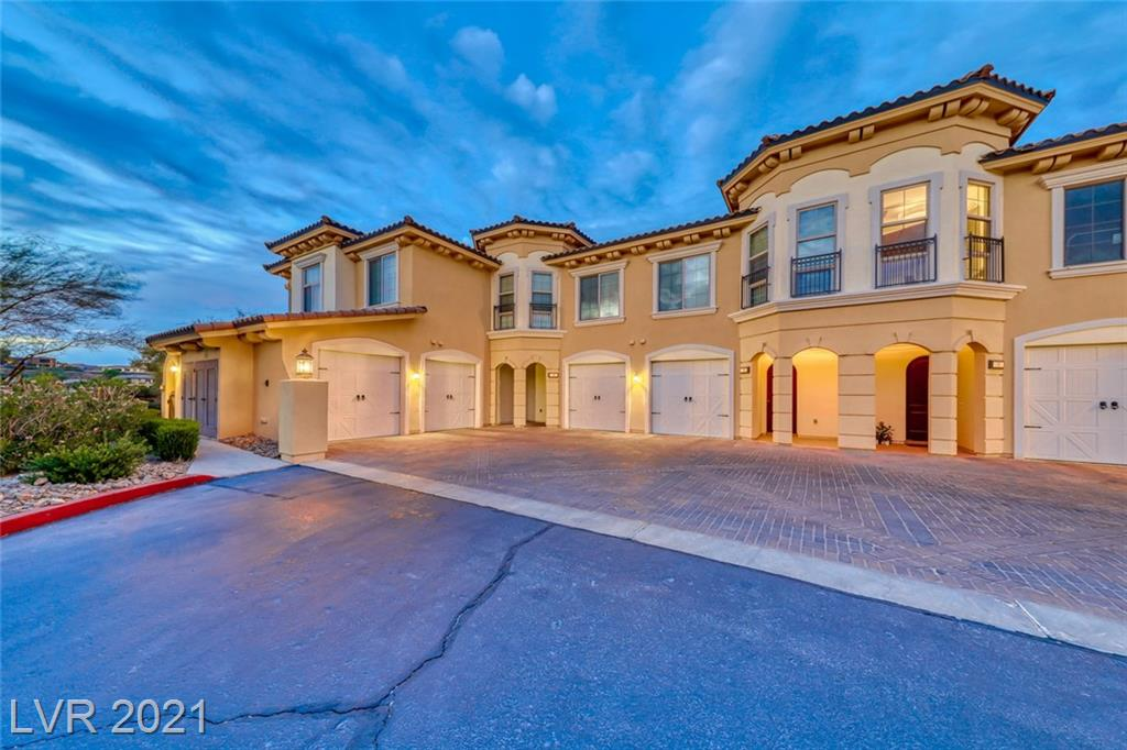 One of a kind single story 2 bedroom unit in prestigious Lake Las Vegas. Lake ,mountain and golf course views located in the V Condo community!. A large wrap around patio to enjoy the spectacular vistas. The kitchen offers granite counters, stainless steel appliances including a built-in wine refrigerator. Travertine flooring, crown molding, recessed lighting, and a glass sliding door to the patio area. Primary bath with a separate large walk-in shower. Single-Attached Garage. Community clubhouse includes a gourmet kitchen for entertaining, entertainment room, pools and spas, fitness center, putting green and BBQ area. Resort style living at it's finest.  Lake Las Vegas recently won the coveted award of Best Master Planned Community in Las Vegas.