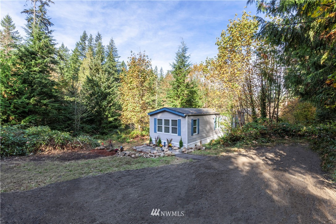 Welcome home to this quiet, secluded 1.26 acres of privacy in the desirable Tahoma School Dist. It's just a short drive to local restaurants, shopping and State Highways. New carpet and fresh paint throughout await your furnishings in this wonderful 2 bedroom, 2 bath mobile. Spacious, bright kitchen with all appliances staying. Plenty of flat, usable acreage for a bigger dream home, garage or barn. Water, power and septic all good to go! New and inviting landscaping really make this home shine.