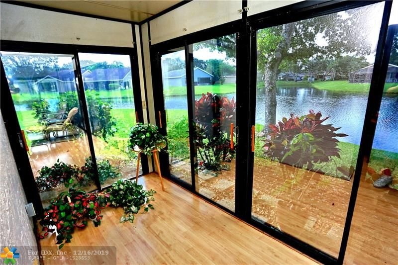 ENJOY THE SPECTACULAR LAKE VIEW FROM THE OVER SIZED GLASS ENCLOSED FLORIDA ROOM OF THIS WONDERFUL HOME IN TAMARIND VILLAGE*A 55+ COMMUNITY WITHIN THE TOWNSHIP*THREE BEDROOMS*2 BATHS* 10x07 WALK IN CLOSET*SPACIOUS ROOMS*VAULTED CEILINGS*TILE FLOORS*1 CAR GARAGE PLUS A LONG DRIVEWAY THAT WILL ACCOMMODATE 2 CARS*CUL DE SAC LOCATION*BEAUTIFULLY REMODELED KITCHEN WITH WOOD CABINETS W/ SOFT CLOSE FEATURES, GRANITE COUNTERS & CONVENIENT PULL OUT STORAGE*NEWER APPLIANCES & AIR CONDITIONER REPLACED 2012*HURRICANE IMPACT WINDOWS*COMMUNITY AMENITIES INCLUDING FITNESS CENTER, THEATER, HEATED POOLS, HOT TUB, SAUNAS,WALKING PATHS PLAY GROUNDS & SO MUCH MORE*