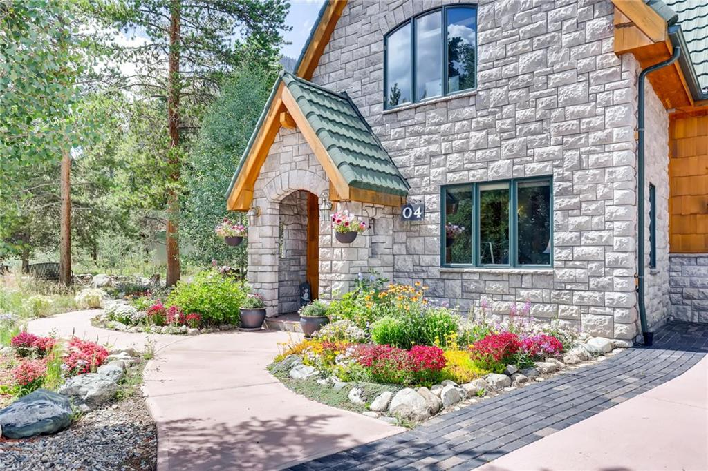 This fairy tale home is on a rare .51 acre lot that is walkable to town yet feels like it is in the forest.  This home has been rebuilt with radiant heat, and oversized windows with the feel of living in a treehouse. Honed copper quartzite and solid maple floors throughout the home and stainless appliances with black pearl granite counters in the kitchen.  Vaulted, sloped ceilings  in the living room which lend unique character.  The lot is full of wildflowers, stone paths and a flagstone patio.