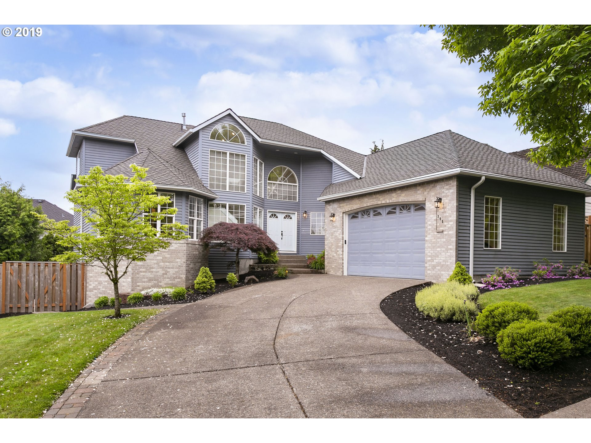Stunning executive home in Waterhouse & close to Nike/Intel/dwntown. 5K+ sqft of living across 3 flrs. Inclds 2,000 sqft daylight bsmt which can be a suite for caretaker, inlaws, home office, or a lrg family. Two furnaces w/ A/C, two kitchens, two FPs, two fam rms, etc. Fncd yrd w/ deck, bltin vac, main flr mstr suite, vaulted ceilings, & flexible living options. Wlkng dist to parks, schools, shops, cafes, THPRD rec center, more!