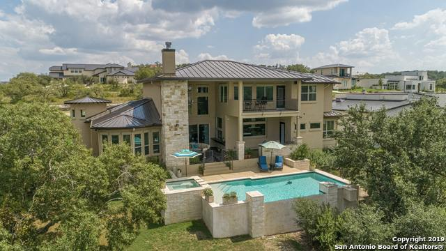 Escape to the Hill Country in this incredible open floor plan estate! Gourmet kitchen w/Thermador appliances,6-brnr gas cooktop w/griddle,dbl ovens,prep island w/sink, huge pantry, & passthrough window to combine indoor/outdoor entertaining.Formal dining w/gorgeous beverage grotto. Luxurious master retreat. Study. Media/Gameroom. Guest bdrm downstairs. Spacious covered patio w/fireplace & outdoor kitchen w/grill & smoker. Impressively private infinity edge pool w/oversized spa nesteled between mature trees.