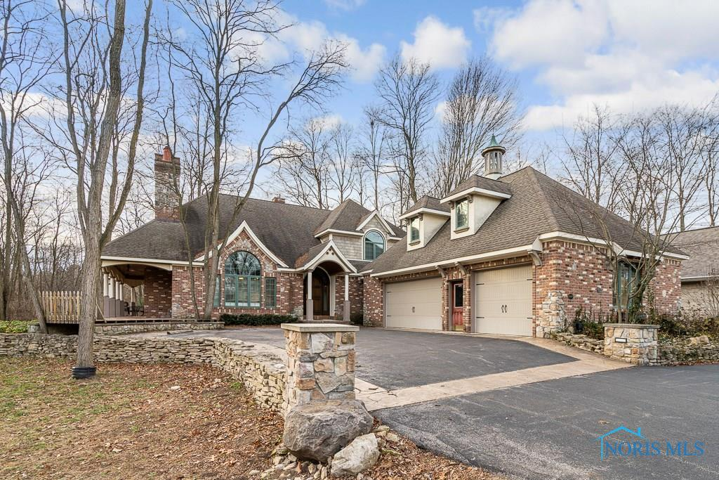 This Custom Build is a must see. Highest quality materials with special details everywhere. Radiant heat floors throughout with 6 temp. zones. Open floor plan gourmet kitchen with granite, custom mahogany cabinets. Heated porch flooring overlooks secluded wooded lot. Full finished basement with theater room and 1/2 bath. Bonus 30x20 efficiency suite with separate entrance.