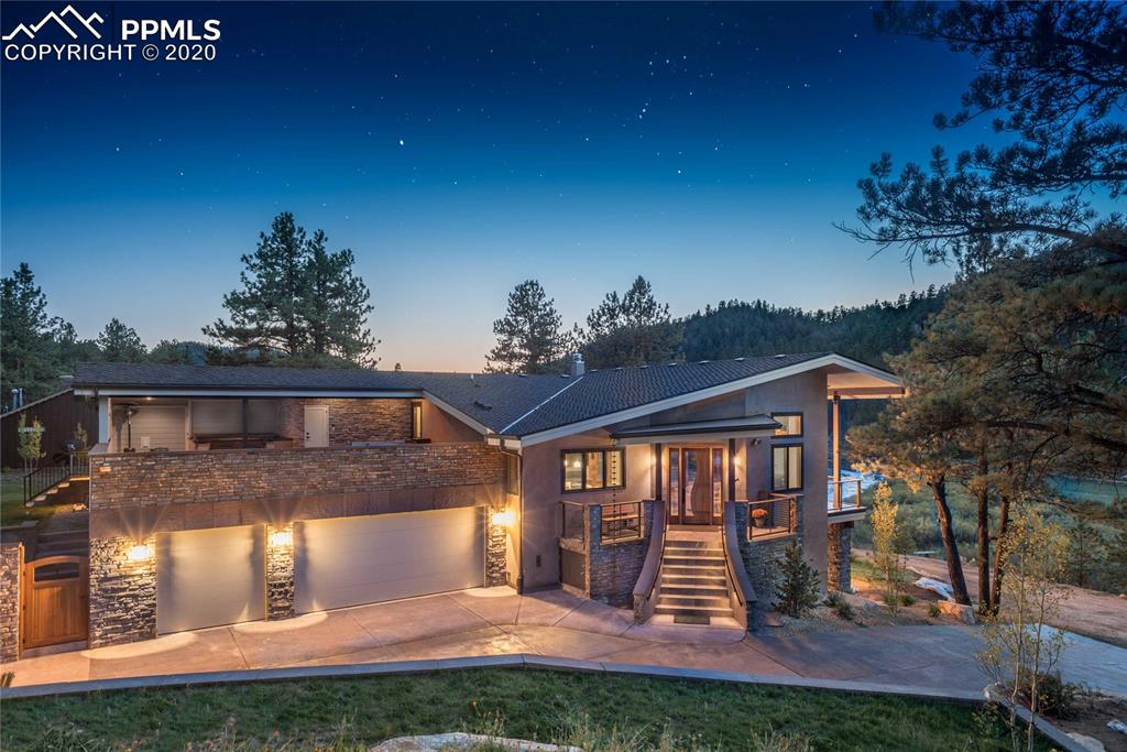 """Traditional Aesthetics seamlessly marry modern features in a sleek contemporary design. This home is the gem of """"Sportsmen's Paradise"""", an estimated 140± acre shared amenity community right on a trout filled 1.6± mile stretch of the South Platte River bordering the Pike National Forest. This home is stepped into a gently sloping hillside wrapped in a pallet of colors derived from those found in the natural surroundings, some landscape materials excavated from the site complement the bold roof lines and modern features."""