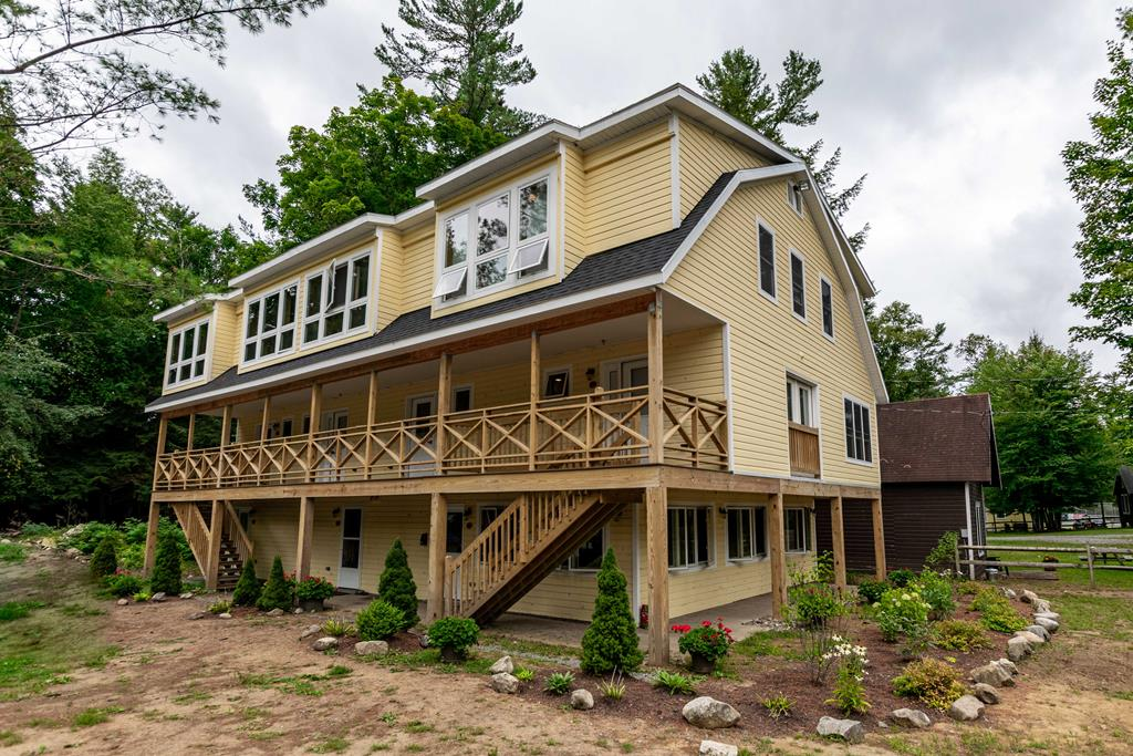 """This Carriage House Town home called """"Eagles Nest"""" is located next door to the fabulous Woods Inn. Imagine being able to stay right near Fourth Lake, rent a dock in an assigned dock space and use the waterfront during the summer. The winter time brings it's own benefits of snowmobiling right from your door or taking advantage of all the wonderful winter activities. You can dine right at the Inn, grab a beverage and socialize with ease. This Unit #802 offers two bedrooms and full bath on the upper floor, Full kitchen with stainless appliances, including a dishwasher, dining area and living room with gas log fireplace and half bath on the first fl. Monthly fees include: heat, network, and taxes. Additional costs are electric, and dock rental if you choose. Included in the purchase is a Wellness Workout Center with state of the art equipment, laundry, full shower and additional relaxing space. Renting is a breeze if you care to use the Inn's rental program including booking and cleaning."""