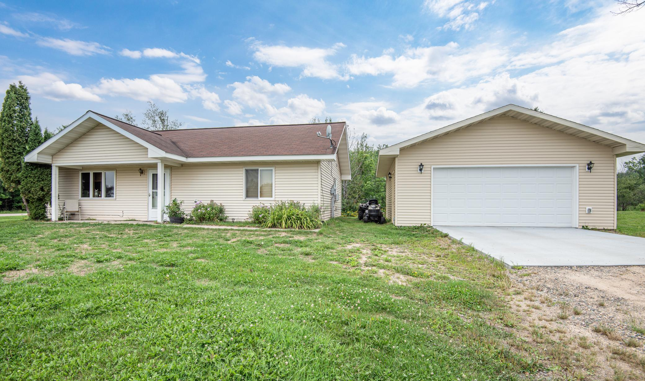 Lovely and  spacious one level living! Your 2 bedroom 1 bath home has in-floor heat, main floor laundry, open floor plan, new laminate wood flooring, new bedroom carpeting and extra wide doorways as well as maintenance free siding. You will also enjoy the new 24' X 24 garage with it's concrete flooring and electric installed.  For your entertaining convenience you have a large 20 X 20 deck. This home sits in the newer home area of Nashwauk and is connected to city utilities.   It's all here, everything that you say you want!
