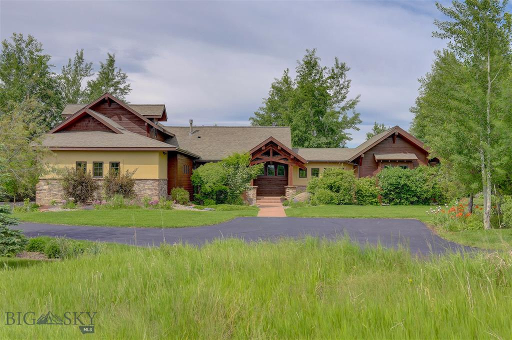Welcome home to your Montana dream! A Reid Smith Architects design that enhances the sweeping views of the Gallatin Range, Spanish Peaks and rolling farm land.  The mature landscaping surrounding the home frames the spectacular views from your main floor living room, and master suite creating a sense of privacy.  The lower level offers natural light and plenty of area for entertaining including a large bonus room and theater room.  Upstairs are two well appointed bedrooms with a bathroom.  Outside is a large patio to enjoy those Montana sunsets or entertain your friends and family.