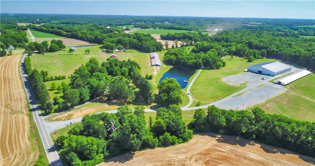 Beautiful property with home, event arena, barn and outbuildings, pastures and wooded areas