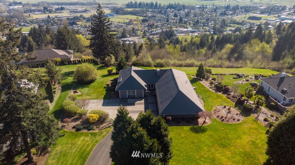 Enjoy panoramic views from this impeccably maintained 2,772 sf, 3 bed, 2.5 bath, single level home on .96 acre lot in the upscale, gated community of Alderwood Heights. The open concept floor plan boasts a beautiful kitchen w/granite counters and SS Sub-Zero & Wolf appliances, perfect for entertaining. Large laundry room and half bath off kitchen. The spacious master suite includes an extra large walk-in closet with built-in organizers. Oversize driveway w/extra parking; 3-car garage w/heated workshop and plenty of storage space. Curb appeal galore with professional, low-maintenance landscaping. Don't let this home get away!