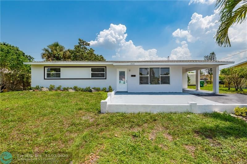 Fully remodeled 3 bedroom 2 bathroom home in Lauderhill!Home features Brand new roof with 10 year warranty.New kitchen with custom soft close cabinets with quartz counter tops. Remodeled bathrooms with custom vanities and new tile.New laminate  flooring with fresh neutral paint throughout.. New tank less water heater with washer and dryer hookup in laundry room. Large backyard with beautiful fruit tree with fresh landscaping finishes this lovely home.