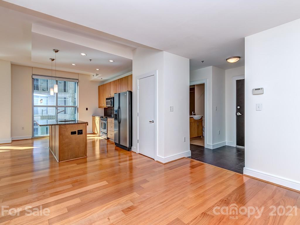 Gorgeous two-bedroom, two-bathroom condo in the heart of Uptown with breathtaking floor-to-ceiling windows with a bird's eye view of the city skyline. This unit was freshly painted and features hardwood floors and high ceilings. The primary bedroom was freshly carpeted and has an en-suite bathroom with a walk-in closet and a large bathroom along with a stunning view from floor-to-ceiling windows. The windows have upgraded solar shades along with custom window treatments. This unit has two deeded parking spaces! Be sure to not miss Trademark's amenities with the excellent fitness center and huge pool with an oasis of a pool deck located on the 7th floor.