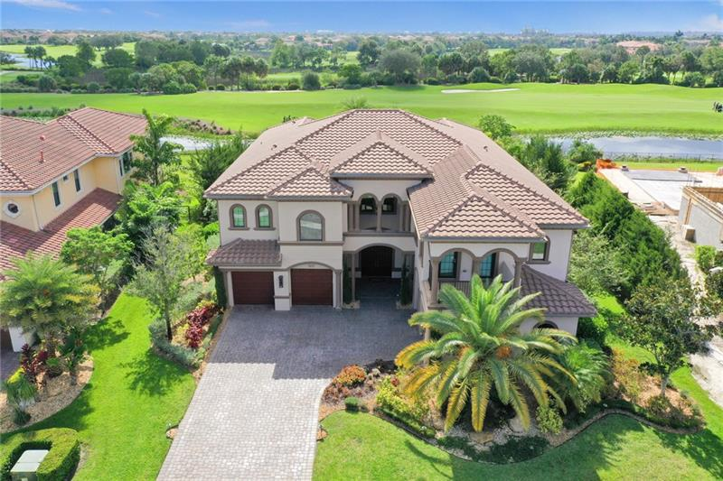 """Elegance,Sophistication and just plain fun describes this exceptional custom Resort styled home. The interior features a spectacular grand entry with split staircases opening into casual floor plan. The first floor includes formal dining, massive gourmet kitchen with all the finest appliances including 3 built in Sub Zero wine coolers. The kitchen spills into a spacious family room that creates a great social flow. In addition, find a jaw dropping lounge bar leading to a large pool/spa with beach area and swim-up bar surrounded by Professional landscaping, lighting, sound systems,outdoor kitchen and fire events. Upstairs, The Spacious Master suite and balconies will deny you nothing. Huge Bath and closets prevail in this """"Cosenza """" Model.  Continue to Supplemental Remarks."""