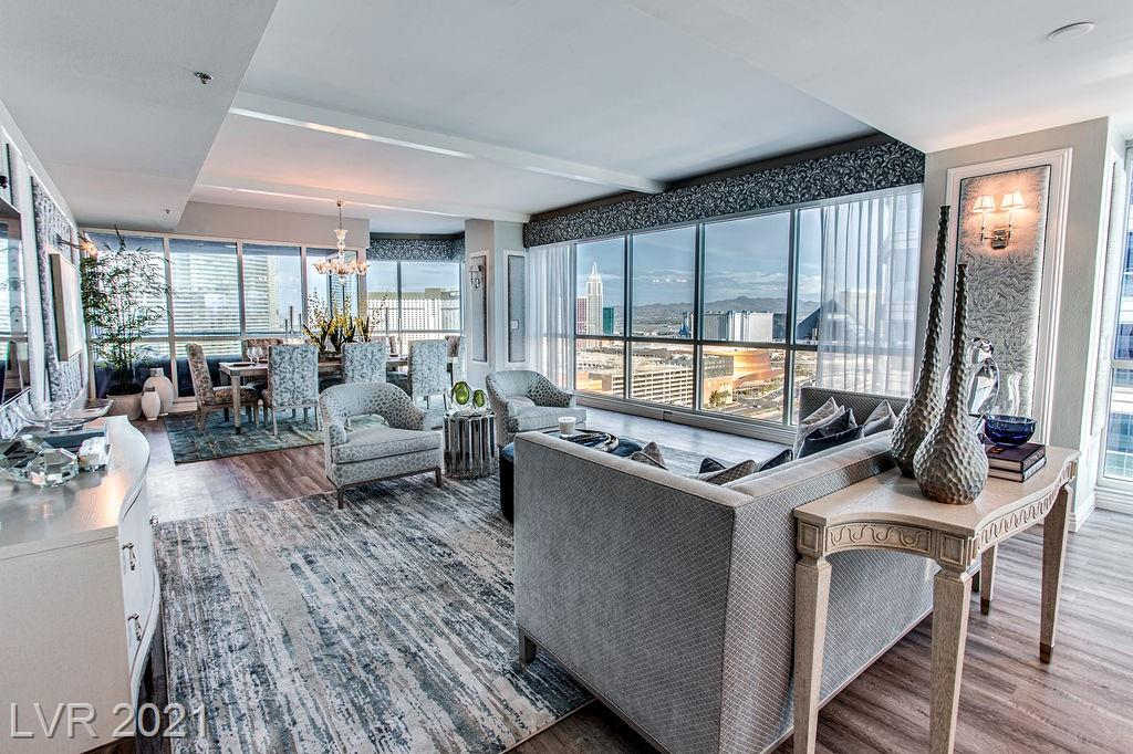 """FULLY FURNISHED 2-BEDROOM/2.5BATH, NEVER LIVED IN """"STUNNING"""" HIGH-END REMODEL BY DESIGNER CHRISTOPHER TODD AT PANORAMA TOWERS! New EVERYTHING! From the flooring to kitchen, to bathroom wallpapers, to framed tufted artwork, to designer mirrors, area rugs and lighting .... this extraordinary condo is about as picture perfect as it gets! And did we mention VIEWS, VIEWS and MORE VIEWS!?  Direct East/South facing Strip & West to the gorgeous mountain sunsets ... each with it's own Terrace! Kitchen features Quartz counters, glass tile backsplash and stainless steel appliances. Gorgeous Living Room / Dining Room combination well appointed for entertaining w amazing views. Separate Family room showcases views to the west. Amazing Master Suite features carpet w rolling shades, walk-in closet and a rest-easy view to the west, along w Master Bath featuring quartz counters, dual sinks, separate shower/deep soak tub. Second BR also faces west w carpeting. Just pack your bags - WELCOME HOME!"""