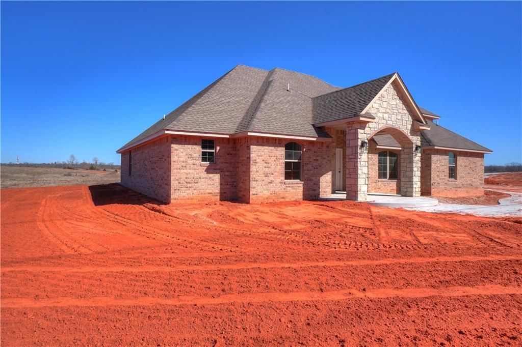 Under construction, still time to choose colors.  Less than 1 mile from OKC fire station.  Horses ok here!  Shop ok too.  Split bedroom plan with bonus room or 4th bedroom upstairs.