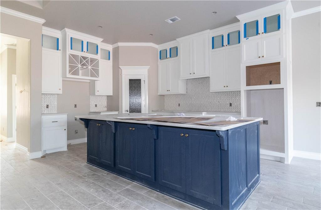 This Shiloh Half Bath PLUS floor plan includes 2,525 Sq Ft of total living space, which includes 2,250 Sq Ft of indoor living space and 275 Sq Ft of outdoor living space. There is also a 665 Sq Ft, three car garage with storm shelter installed. Home has 4 bedrooms & 2 and a half baths. The living room has a coffered ceiling, gas fireplace with stack stone surround, 7 ft windows, barndoor, and wood look tile as main flooring! Kitchen has stainless steel appliances that include a built in gas range and electric oven, dishwasher in the island, as well as a microwave. Custom cabinetry to ceiling and 3cm quartz counter tops, and trashcan pullout. Master bedroom comes with a double sink vanity concept, Jetta Whirlpool tub, walk in shower and walkin closet with seasonal racks. Home has Smart Home Technology, Rinnai Tankless water heater, whole home air purification system, R44 Insulation & solarboards! Back Patio is covered with 10 ft ceiling, outdoor fireplace, and gas/cable lines.