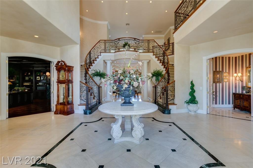 Elegant original owner/builder custom home on golf course w/panoramic double fairway, mountain & sunset views. Exquisite design & attention to detail by World renowned designer. Grand foyer, double spiral wrought iron staircase. honed stone floors, elevator. All en suite bedrooms (2 down) quality craftsmanship in extensive built-ins throughout. Hand painted borders, faux & glazed walls, crown molding. Crestron lighting, leaded glass. Pella windows & doors. Stunning cherry wood office w/coffered ceiling & marble fireplace. 2nd office down w/built-ins, access to pool. 2 family rooms w/wet bars & built-ins. Theatre room. Spacious primary bedroom w/sitting room with wet bar & access to balcony. Gorgeous marble primary bath, steam & separate spa tub. The pool & spa are a masterpiece in design, extensive covered patios. 195 ft. frontage on golf course.  4 car garage, circular drive.  Will sell furnished.  9277 approx square footage.  Tremendous value.