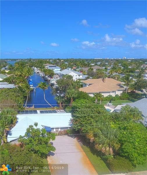 A boaters dream home with quick easy access to the Ocean. Waterfront home located in the heart of Jupiter. Enjoy your morning coffee looking out your large picture window down the canal. Features: 1 sty, CBS const., 2/2, 1 car gar., solar heated open pool, scrn pch, boat dock, dock box, ceramic tile or wood flooring throughout, built in murphy bed in guest room, built in desk & work area in guest room, cabana bath, crown molding, double glazed windows, 6600 watt generator. Newer - A/C unit, handler & duct work, appliances, roof, interior & exterior paint, built in's, windows. This canal opens up into the Loxahatchee River. Just minutes by boat to Jupiter Inlet, Atlantic ocean, sandbars & restaurants. This is a must see home that anyone would be proud to call home!!!