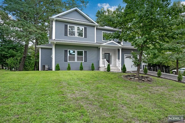 Spectacular Newly Renovated Home in Desirable Fanwood! This gorgeous colonial features 5 beds, 2.5 bathrooms, a finished basement, gourmet kitchen, spa-like master bath, & more! Fanwood/Scotch Plains school system. Gourmet kitchen with Island, built-in microwave cubby, high-end Stainless steel appliances, recessed lighting and natural lighting throughout, 2-story foyer with luxurious long chandelier, finished basement with endless possibilities for game room and home movie theater, master bedroom suite with his and hers walk-in closets, master bathroom with large-jacuzzi, separate toilet room, spa standing shower, double sinks. This house has it all!! Please wear booties or remove shoes at the door to preserve the floors. Thank you!