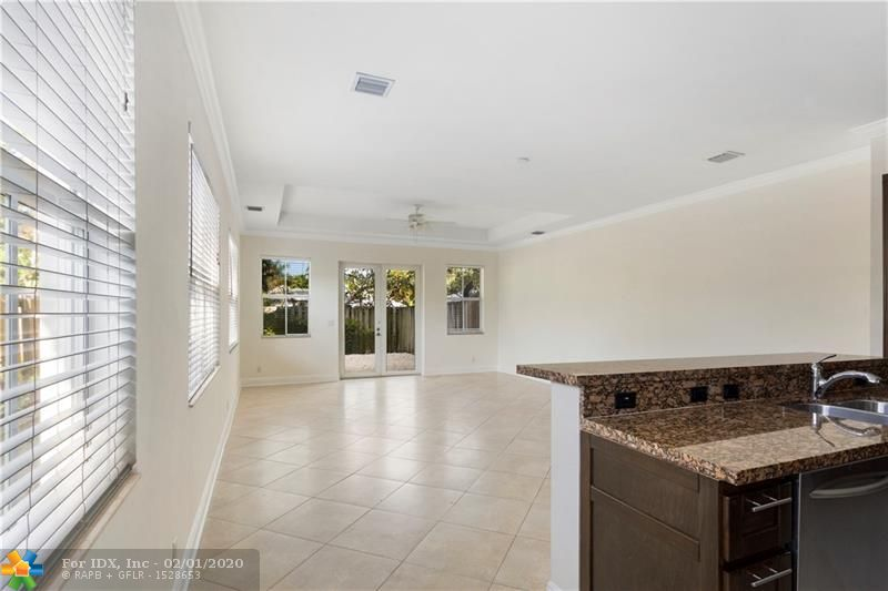 Welcome home! This beautiful and rare 3,023 sq ft 3-story townhome is located in one of the most popular areas of Fort Lauderdale, Tarpon River. It is located minutes away from Las Olas, Publix, the new Whole Foods, restaurants and stores. The townhouse was just re-painted on the exterior and interior and wood floors refinished. It is the BEST DEAL in Tarpon River.  It is a fee-simple deed with no monthly fees. It includes two master bedrooms in the second floor. The third floor includes  an additional bedroom and bathroom plus a large open den and the roof terrace.  DO NOT MISS THIS OPPORTUNITY! ** Sq Ft under a/c is based on tax roll, buyer to verify at their own discretion **