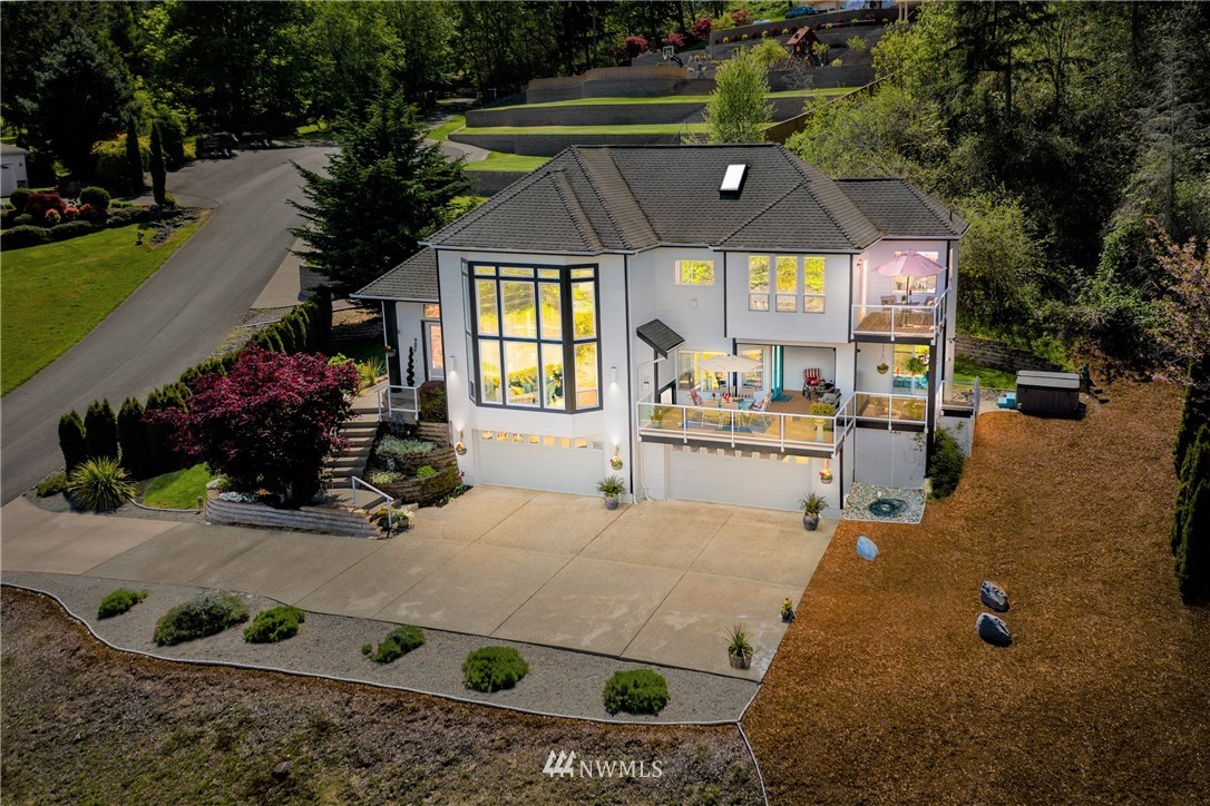 Custom treasure embracing Fox Island's tranquil lifestyle & vibrant Hale Passage views through cascading walls of steel framed windows.  Thoughtful design & meticulous detail transition from grand soaring gathering spaces & guest rooms on the main level to the intimate, light filled, private master retreat & den above.  The open kitchen is truly the heart of the home.  Multiple decks, 3 fireplaces, 4+ car attached garage w/ full bath, exceptional storage, professional landscaping, 1.25 acres!