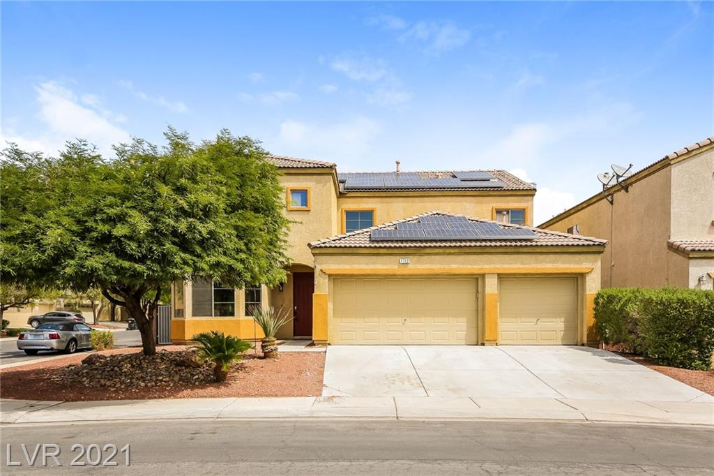 This North Las Vegas two-story home offers a three-car garage.