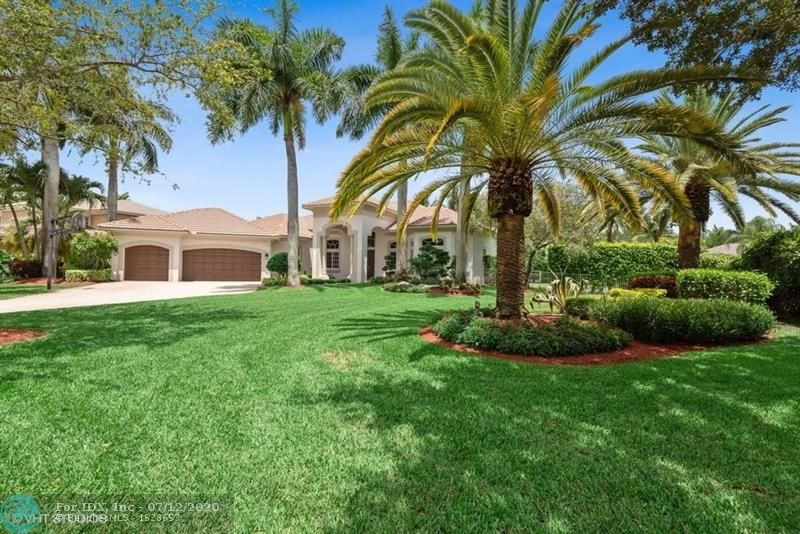 Welcome home to this gorgeous oversize lot in Fox Ridge Estates! Beautiful open & bright, full of natural/light split floor plan. Stunning new kitchen, marble backsplash, quartz counter top, Allavino wine fridge, walk-in pantry, Travertine tile floors through out family room, living room & formal dining room & crown molding. 5 bedrooms (one used as an office) Breathtaking backyard w Travertine patio, custom built in bbq w outdoor bar, screened patio perfect for entertainment. Salt water pool w Jacuzzi & waterfall. Brand new exterior paint & lush tropical landscaping. Picture perfect park like setting neighborhood, 24 hour guard gate, many amenities, playground for the little ones, volley ball court & tennis courts w jogging path.  A+ schools, beautiful parks & youth sports programs.