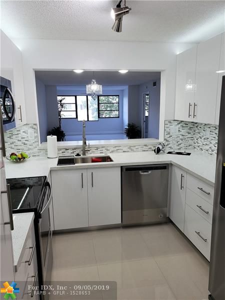 YOU JUST CAN'T WAIT TO SHOW THIS TO YOUR FRIENDS!  READY TO MOVE IN,  ABSOLUTELY EVERYTHING IS BRAND NEW!  COMPLETELY REMODELED, NEW KITCHEN CABINETS, QUARTZ COUNTERS, S/S APPLIANCES,  BATHROOMS COMPLETELY REDONE TOO.  SPECIAL INNOVATIVE LED LIGHTING THROUGHOUT,  LARGE RECTIFIED PORCELAIN NO GROUT TILE THROUGHOUT.  CLOSETS REDONE WITH NEW SHELVING.  NEW S/S WASHER AND DRYER IN LAUNDRY ROOM.  ENJOY THE RELAXING WATER VIEW.  KINGS POINT HAS MANY AMENITIES, CLUBHOUSE, COURTESY BUS SERVICE FOR SHOPPING, DOCTORS, ETC., AND PALACE THEATRE FOR ENTERTAINMENT.  CLUBHOUSE DEED HAS BEEN PAID IN FULL FOR LOWER MAINTENANCE.  ASSOCIATION REPRESENTS ITSELF FOR THOSE AGE 55+.
