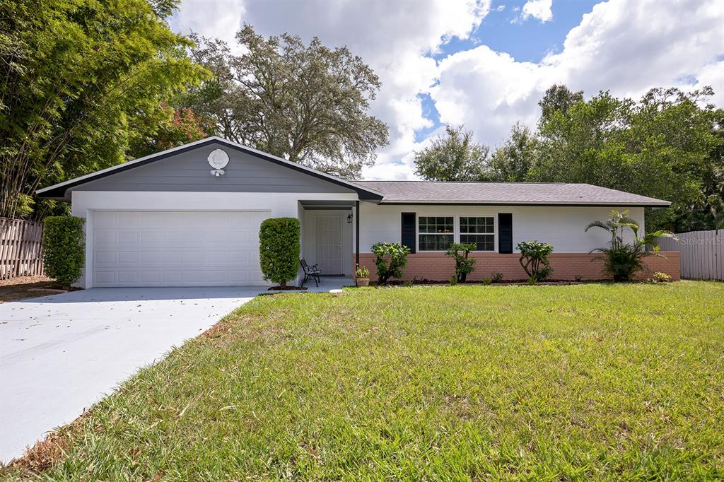 Nestled on a .27 acre lot in the quaint family community of Indian Hills in Casselberry, sits this beautifully renovated MOVE-IN READY POOL HOME. Just minutes from Top Rated Seminole County Schools. This incredible 4 bedroom 2 bathroom single story home has a bright open floor plan with new energy efficient dual-pane windows (2021), new gas water heater (2021), new interior/exterior paint (2021), updated kitchen, updated bathrooms, updated light fixtures, whole house water softener, new carpet (2021) and new vinyl floors (2021). The renovated kitchen has new cabinet doors (2021), stone countertops, stainless steel appliances, new microwave (2021) and new side-by-side refrigerator (2021). It opens to a spacious family room with a new ceiling fan and sliding glass doors that lead out to the screened-in back porch. The primary bedroom boasts of new windows that overlook the pool, new carpet and an en suite bathroom with a high efficiency toilet (2021), new  vanity countertop (2021), new cabinet doors (2021) and new sink with faucet (2021). The guest bedrooms feature new carpet, new closet doors (2021) and a hallway bathroom with a new vanity (2021), shower/tub, new fixtures (2021) and high efficiency toilet (2021). Outside, the fenced-in backyard highlights a sizable open air patio with in-ground pool, new pool pump (2021) and a 11 x 32 screened-in back porch. Additionally, there's an oversized 2 car garage with newly painted floors (2021), new garage remotes (2021), Roof (2017), A/C (2012) and no monthly HOA fee.