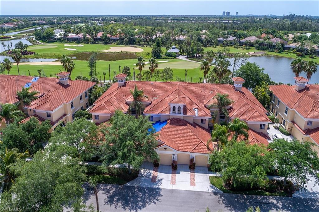 Imagine the amazing sunsets from this upper floor immaculately maintained coach home with southern exposure, golf course and lake views with screened balcony. Pavered courtyard entry to the open concept living area and is open to the balcony bringing the outdoor space in. The living space boasts volume ceilings, tile set on the diagonal, and recessed lighting. The kitchen features light and bright custom cabinetry with glass inserts, tile backsplash, gas cooking, stainless steel appliances and kitchen nook with custom archways. The master suite features coastal decorating, wood floors, large walk-in closet, and a beautiful view of the golf course. The en-suite has dual sinks, walk-in shower, and private water closet.  2018 Updates: Interior Painting including garage, new refrigerator, gas stove, master bath lighting, custom closet organizer. 2017 upgrades: Washer and gas dryer. Other upgrades include ceiling fans, hardwood flooring in bedrooms and stairs, new dishwasher and AC replaced.