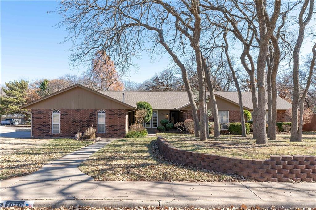 Beautiful Brentwood home in East Edmond located just minutes from shopping, restaurants, I-35 and Broadway Extension. You will love the floor plan, over-sized bedrooms, updates, and bonus room. The living room includes a wood burning fireplace, built-in bookcase and new flooring. The kitchen offers a breakfast nook, gorgeous brick floors, granite countertops, stainless steel appliances, an electric cooktop, and microwave. The master suite is very spacious with his and hers large closets, double vanities, heated floors, and walk-in shower. Great built-in storage in the hall. Open the middle bedroom's shelving to a hidden BONUS ROOM! Equipped for a theater room or could function as a fourth bedroom. There are new windows throughout the house letting in all the sunlight. Laundry is inside of the garage and kitchen with 1/2 bath. You will love the mature trees in the front yard and the spacious back yard with a fire pit, all on a corner lot! Schedule your showing today!