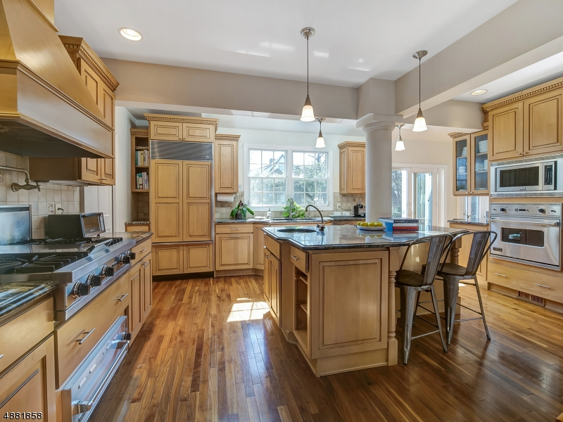 RARE Opportunity in Desirable Washington Park Cul-de-Sac Neighborhood! Must-see light filled CH Colonial w/ Gorgeous Open Floor Plan Gourmet Chef's Kitchen.Jitney to NYC-Direct train on corner. WOW! Move right in! EIK w Skylights, Oversized Island, Viking, SubZero, Miele+Pantry. Dining Room Adjacent to K itchen, LARGE Living Room w Recessed Lighting and WBFP leads to Heated Sunroom and Door to Patio and Fenced in Rear Yard w Play-set. 3 Large Bedrooms on 2nd floor w Master En-Suite. 4th BR: add'l Master Suite suitable for, Guests etc. Finished Lower level w RecRoom, Laundry, Workshop + Storage. Hardwood Floors, Custom Millwork, CAC, Newer Windows, Updated Electric, Attached Garage. Located near 'Ridgewood Row' Coffee+Shopping and 'Orchard Park'. Close to Maplewood and South Orange downtowns trains.
