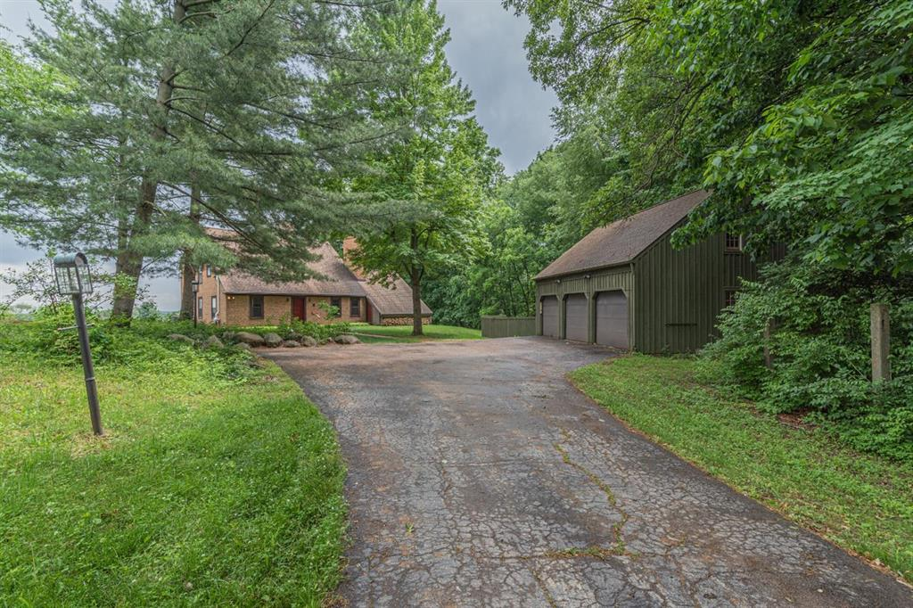 Come see this outstanding unique Saltbox/Early American perfectly situated on 40 wooded acres. This gem has 4 bedrooms/3 full baths plus study or guest bedroom. Tons of storage space including cedar closet in walk-in attic off primary as well as third floor attic. Built in 1981 to resemble original owners New England home. Wide plank flooring throughout. Rhode Island blacksmith commissioned to make 35 sets of rod iron hinges/latches for doors and cabinets. Two large brick fireplaces-living room/formal dining-will keep you warm in the winter. Firewood under roof and easy to access. Kitchen has lots of cabinet space, large walk-in pantry and closed flue in place for future wood-burning stove. Forced hot air furnace can be switched to wood-burning furnace to cut heating bills. Basement egress through a Bilco cellar door. Large three car garage with second floor-perfect for hobbyist, car enthusiast or home business. Enjoy evenings/dinner in your backyard enclosed gazebo. Thinking of growin