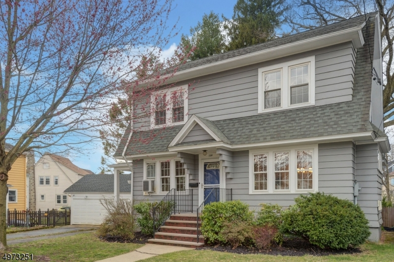 This charming 4 BD/ 2.1 BA Colonial basks in amazing natural light! Situated on a tree-lined street with great community spirit just 1.5 miles from Maplewood's Village shopping, dining & NYC trains! Highlights include: HW floors, a spacious formal living room w/ WB fireplace & french doors to a covered side porch, a formal dining room with built ins, an updated kitchen w/ breakfast bar & loads of cabinet space!2nd floor offers 3 generous size bedrooms & main full bath with a tub/shower combo. The spacious 4th bedroom on the 3rd floor has a large walk in closet, half bath & extra storage space.The lower level offers a full bath, laundry area & tons of storage. Great potential for a rec room! The covered side porch & backyard offer lovely space for relaxing, outside play and gardening!