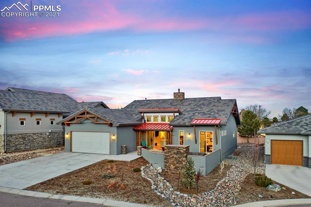Step inside this exquisite custom built modern home located in the coveted Cathedral Ridge at Garden of the Gods Club. Quality shows from outside in!  The front of the house features two outdoor living spaces to soak in the unbelievable Pike's Peak and mountain views. The covered patio has beautiful Redwood tongue and groove ceilings, and the other outdoor space features a custom built gas fireplace. Step inside to open concept living loaded with lots of windows and a front slider to capture in all the light and the views. The 3-sided fireplace and dry bar in the living area lead to a beautiful modern kitchen/dining area featuring high end appliances, quartz countertops, custom soft-close cabinets, and a hidden walk-in pantry. The walk-out master suite on the main level is sure to impress. The 5-piece master bath features a large soaking tub, and a striking walk-in steam shower. Another en-suite bedroom is located on the main level. You will love that the owners added extra padding and upgraded carpet to all the bedrooms. Walk downstairs and get ready to entertain at the custom built wet-bar in the large family room. The concrete floors have been finished and stained to give it a cool contemporary feel, and both en-suite bedrooms are extremely large featuring walk-in closets. Step out to the backyard to another large covered patio finished with the same tongue and groove ceiling. A beautifully landscaped yard and custom built putting green is sure to please all golf enthusiasts. The huge 3-car finished garage with built-in workbench can easily park 3 vehicles. The entire home is pristine, has fantastic space, incredible views, centrally located 10 minutes from downtown, and a few minutes from world class trails and Garden of the Gods Park. Come and view this home today!