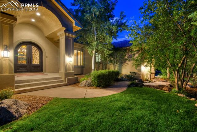 Experience the Privacy & Luxury of the Exclusive Broadmoor Resort Community when you come home to this Immaculate, Updated Hoagie Custom Home.  Nestled in the foothills of Cheyenne Mtn & Beautifully, situated on ½ acre, corner lot with both City & Mountain *VIEWS*.  Fully landscaped grounds compliment a completely new, low maintenance exterior.  *New Front Door, Stucco, Composite Deck, Railing and ALL NEW Kolbe Windows.*