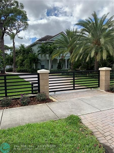 Fabulously refreshed home.  Expanded pool/spa, updated kitchen and baths,  solid core interior doors, marble floors in every room, lushly landscaped and fenced/gated 14,000 sq/ft lot.  One block off Wilton Drive.  Walk to shopping, restaurants and parks.