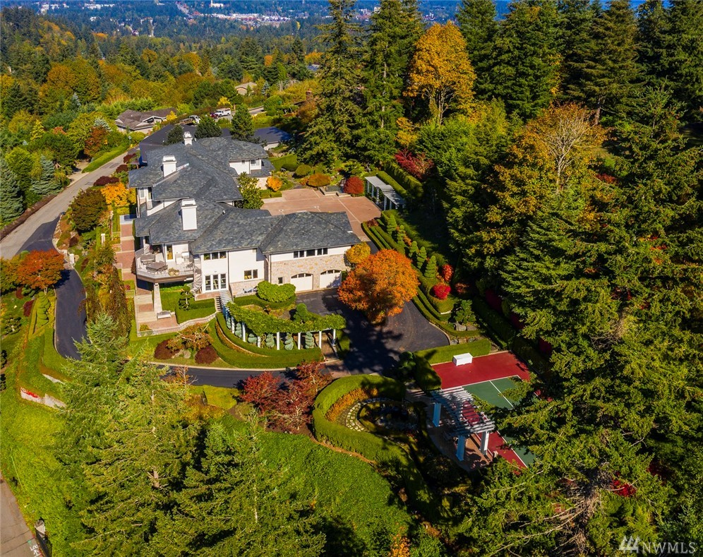 Architectural perfection at Horizon View. First time on the market this home is perfectly sited on over 1-acre of view and manicured grounds. Built by Edifice Construction, no expense was spared. Enjoy views of Seattle, Bellevue & Lake Washington. This is truly an entertainer's dream: Indoor/outdoor living, chef's kitchen, theater, wine & exercise rooms. Only the finest materials: slate roof, sandstone, exotic woods, and stones. No details have been left undone. Rare. Exquisite. Exceptional.