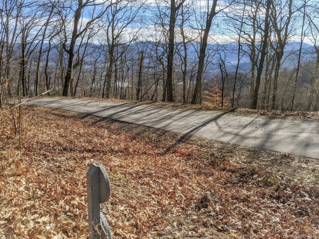 Corner lot @ Avalon.  Wooded homesite with mountain views. Sitting on 1.08 acres, this homesite has maximum view potential.