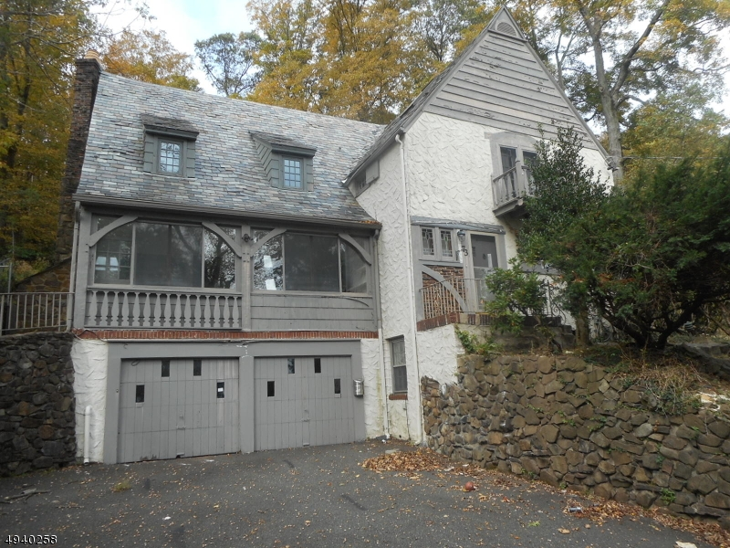 Tudor style home with heated pool. Large rooms, vaulted ceilings, 2 fireplaces, hardwood floors under carpet, and 2 car garage. Eat in kitchen with center island great layout for indoor and outdoor entertaining. Close to schools, parks and public transportation.