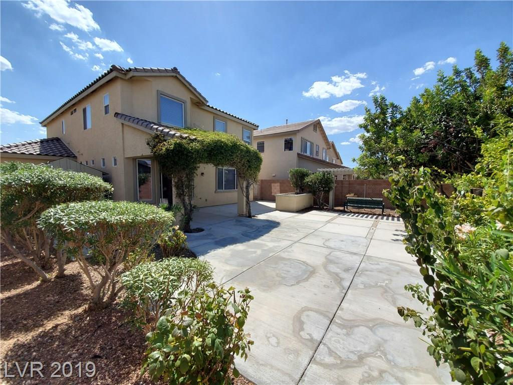 Previous model house Beautiful & well maintained home in Aliante. New Carpet Throughout, Two-toned paint, Tile floors in major areas, Fireplace, 3 bedrooms and a loft, 2.5 bathrooms, 3 car garage, Tile counters w/tile backsplash, Ceiling Fans, Bay Windows & pocket windows for light, Great mountain views, Large master bedroom w/designer master bath. Huge patio and a tranquil backyard with fruit trees and beautiful vegetation. A place to call home!