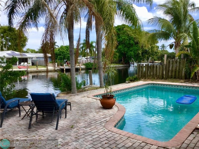 Wonderful central Wilton Manors 3 bedroom, 2 bath waterfront pool home with true one car garage. Enter and experience dramatic direct views of pool and river. Ocean access w/ several fixed bridges - great for Kayaking, canoeing etc. Open kitchen with newer ss appliances, granite counters & bar seating. Neutral tile flooring in main living areas and wood flooring in bedrooms. Updated bathrooms, vanities and floor to ceiling tile. Recessed lighting, crown molding, ceiling fans, closet built ins, tank less water heater & more. Screened Florida room, family room and bonus room. Covered front entry, courtyard, fenced yard, primary driveway plus drive for boat/trailer etc. Perfect location in the heart of central Wilton Manors convenient to shopping, restaurants, nightlife, roadways and beach.