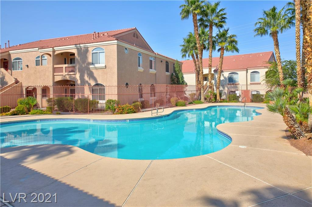 Clean & Move in Ready upgraded 2nd floor condo in Gated Henderson Community! Beautiful oversized windows looking out to the community pool & spa, covered balcony, tile floors throughout, neutral paint colors, soaring ceilings, and Two Primary Bedrooms with Ensuite Bathrooms! Open kitchen to great room with All Stainless Steel Appliances included, stacked washer & dryer, breakfast bar, ceiling fans throughout, and newer water heater, newer ac unit. Community features include clubhouse with kitchen, pool table, 2 fitness rooms, multiple pools & jacuzzis, and plenty of guest parking! Ideal location Minutes away from Target, grocery stores & freeway access!